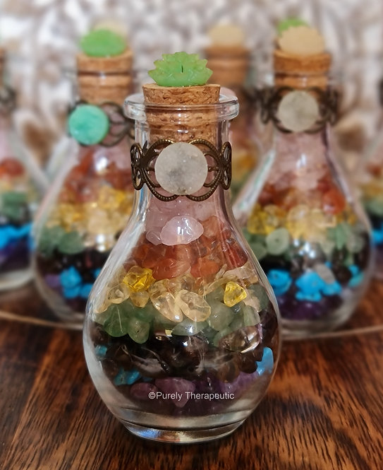 chakra crystal chips in a glass bottle