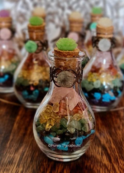 Chakra gemstone chips in glass potion bottle