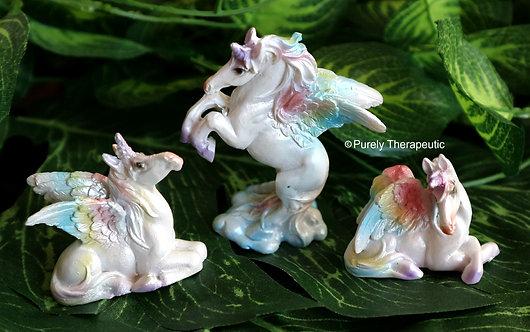 Miniature rainbow and white unicorn figurines