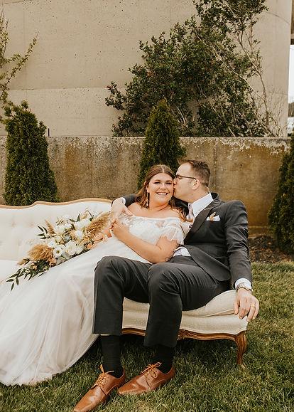 photo of couple outside of barn