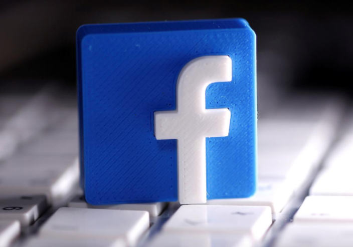 A 3D-printed Facebook logo is seen placed on a keyboard in this illustration taken March 25, 2020. REUTERS/Dado Ruvic/Illustration/File Photo GLOBAL BUSINESS WEEK AHEAD