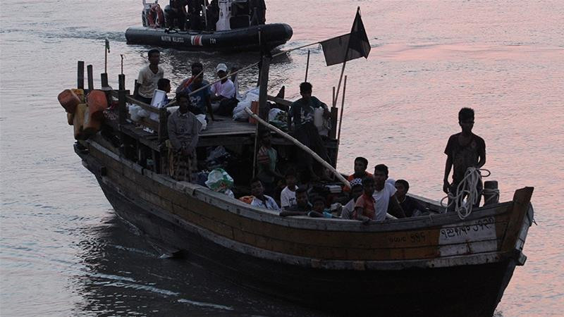 Rohingya refugees intercepted by the MMEA off Langkawi island being handed over to immigration authorities [File: Reuters]