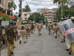 India: Police patrol parts of Bengaluru hit by deadly violence