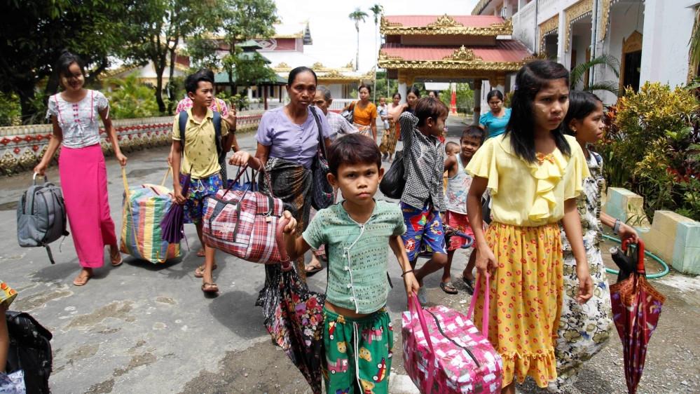 Villagers arrive at a temporary camp with their belongings on June 29, 2020, in Sittwe, Rakhine State, Myanmar [AP Photo]