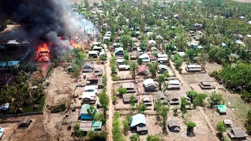 A fire burns in the village of Let Kar in Rakhine State in this photo released by Myanmar's military on May 16, 2020 [File: AP]