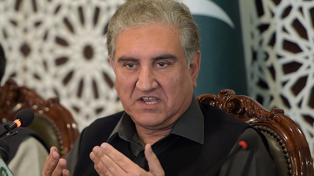 Foreign Minister Shah Mahmood Qureshi urged India to reverse its unilateral actions, stop human rights and ceasefire violations, remove restrictions on communications, movement and peaceful assembly and immediately release Kashmir's leaders [Farooq Naeem/AFP]