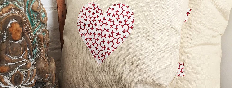 Ivory cushion with heart applique