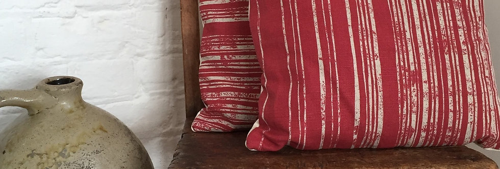 Cushion with funky stripes on red background