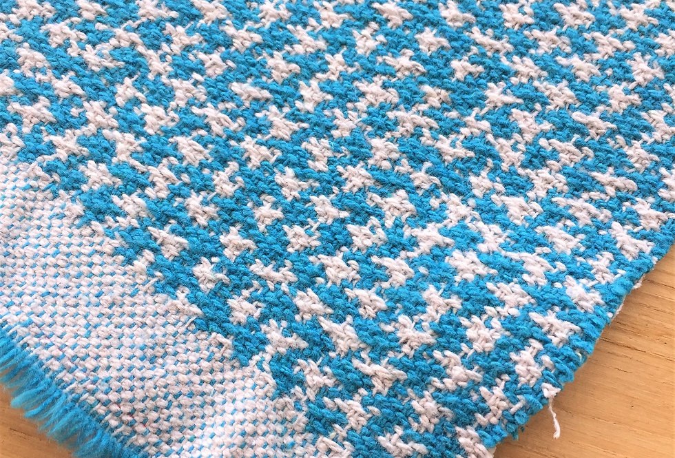 Designers Guild 100% recycled fabric! Turquoise Estrela houndstooth reference.