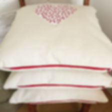 cushions handmade in London with Ian Mankin fabrics, heart applique