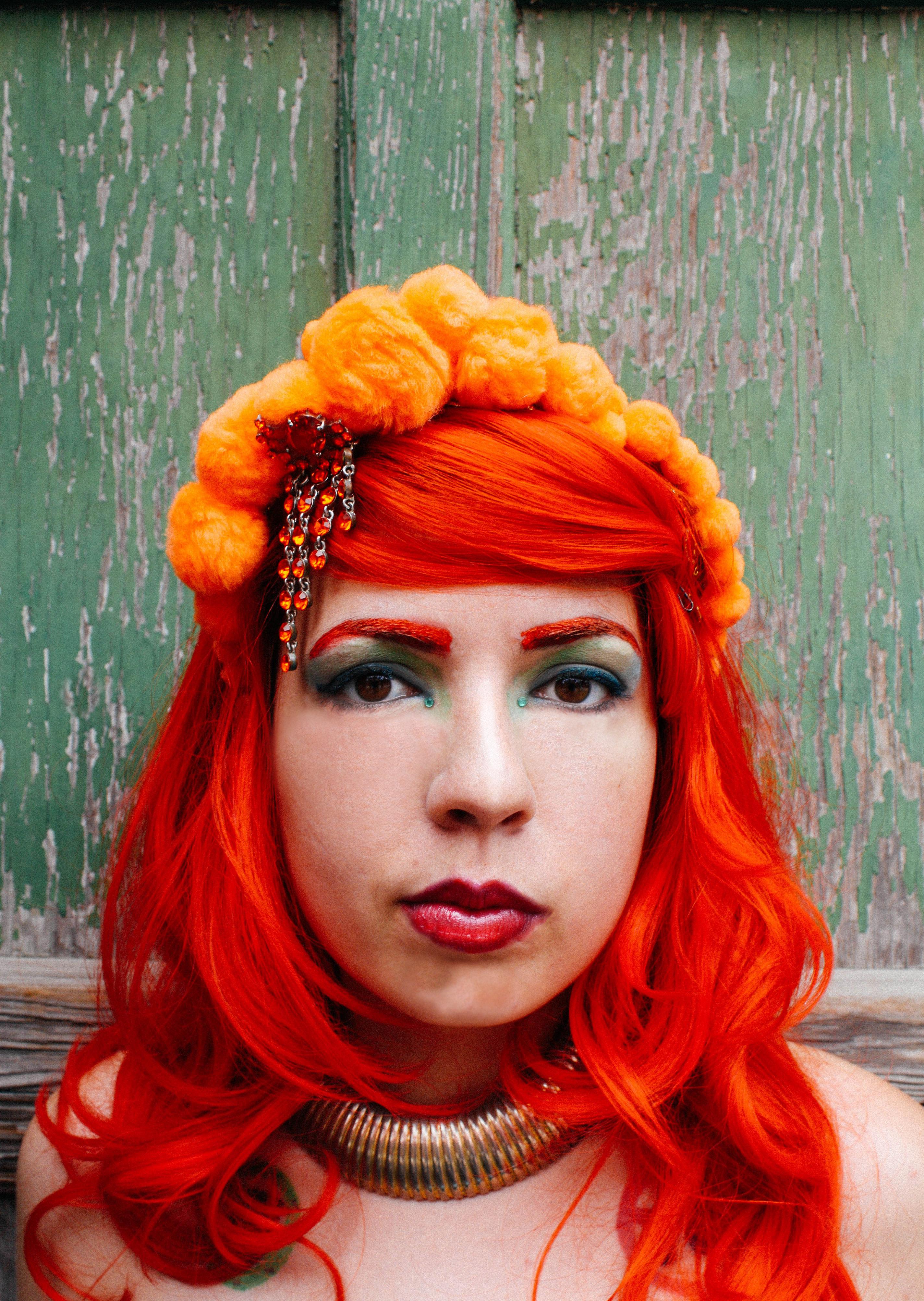 orange pom pom headpiece