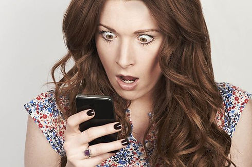 9_A-shocked-woman-looking-at-her-phone.j