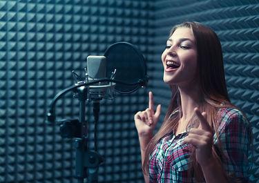 Singing girl in recording studio.jpg