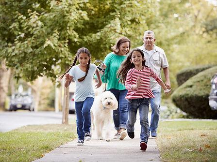 family on sidewalk, life insurance