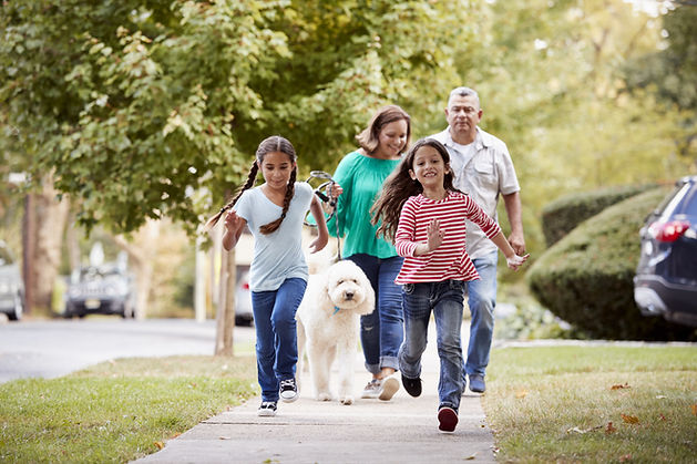 family-on-sidewalk.jpeg