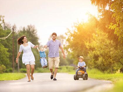 family-walking-sun.jpg