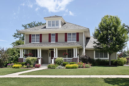 Suburban home with red shutters.jpeg