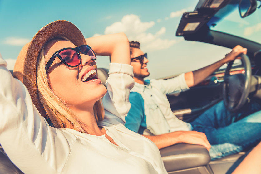 couple happy in car
