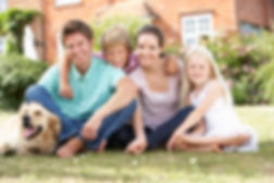 bigstock-Family-Sitting-In-Garden-Toget-