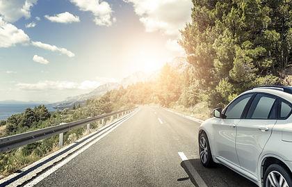 white_car_highway.jpeg