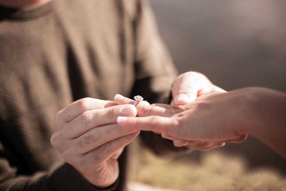 A man making a woman wear an engagement ring