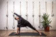 Sarah Jane Rawkins Yoga Teacher demonstrating an extended Warrior Posture