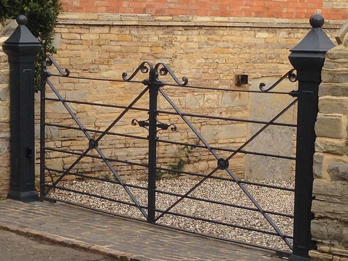 hand forged estate style double gates with feature gate posts