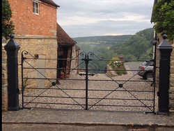 Hand forged gates and posts by Tony call
