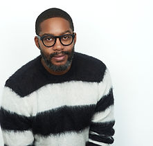 author photo sweater_credit_John Ricard