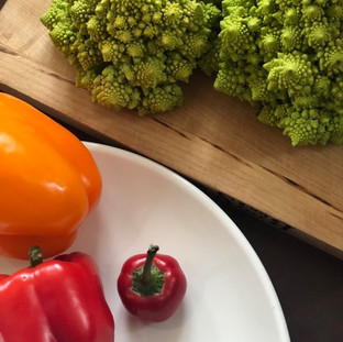brightly colored peppers and romanesco