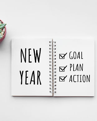 New year goal,plan,action text on notepa