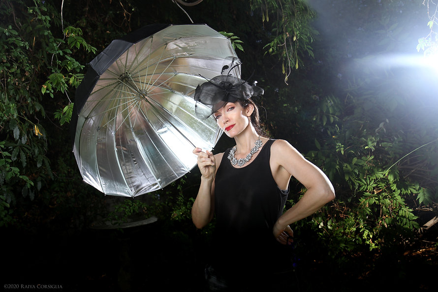 Raiya BIO PIC WITH UMBRELLA.jpg