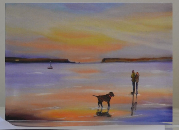 Couple and dog at sunset on the beach, greeting card