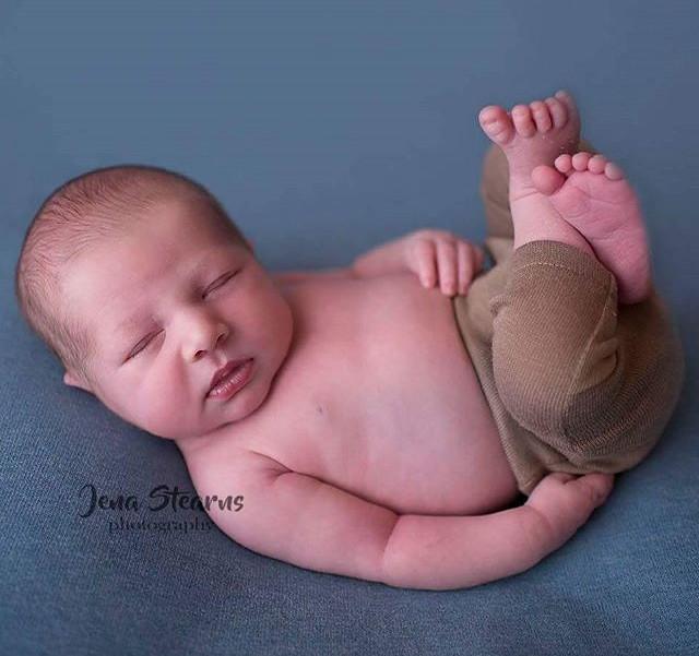 Huck Finn newborn pose