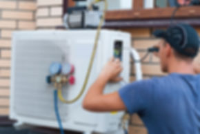 the worker installs the outdoor unit of