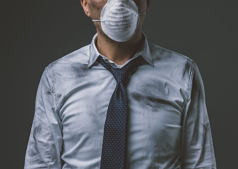 businessman-with-mask-and-air-pollution-