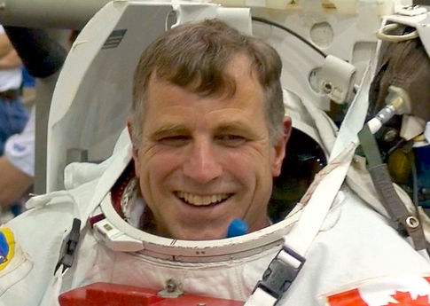 Record-holding Canadian astronaut Dave Williams training for STS-118 spacewalks in spacesuit at NBL Johnson Space Center