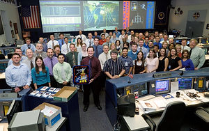 SC2007-E-44448 (17 Aug. 2007) --- The STS-118 Orbit 1 flight control team poses for a group portrait in the space shuttle flight control room of Houston's Mission Control Center (MCC). Flight director Matt Abbott holds the STS-118 mission logo.