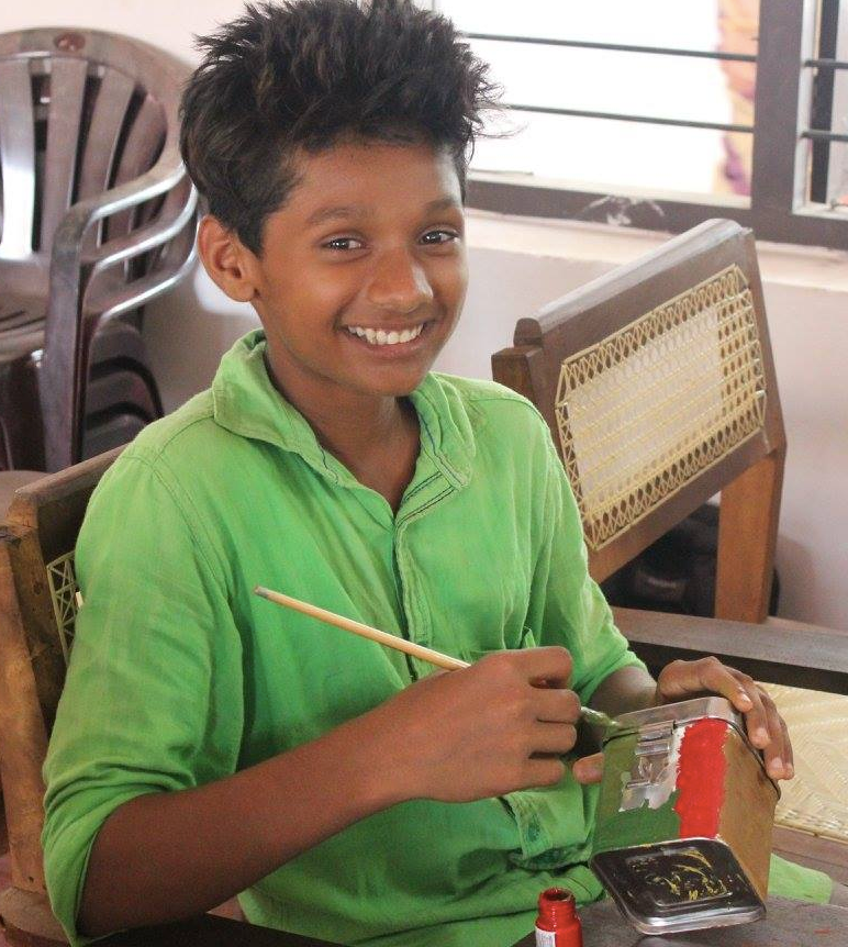 A child enjoys his time as a part of an arts activity organised by Pallium India