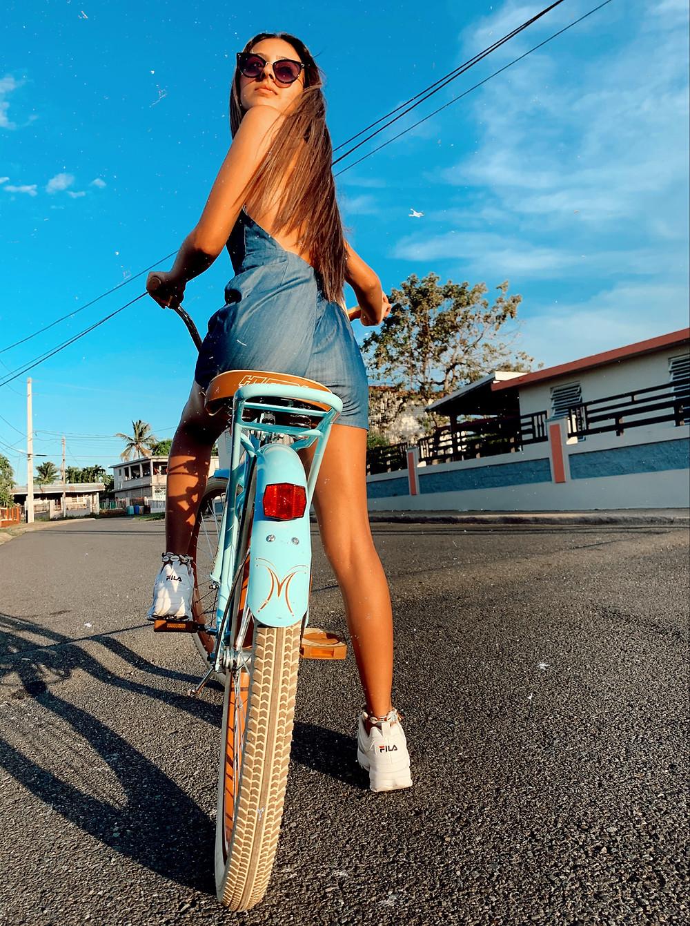 girl on bike by Arliane Vargas