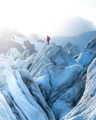 Man Hiking on a Glacier in Iceland