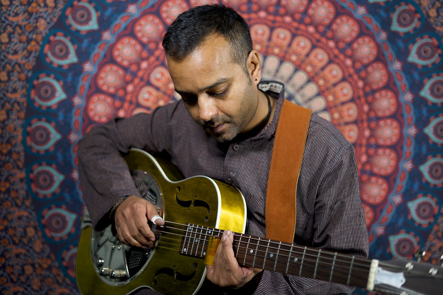 Ajay Gold Guitar.jpg