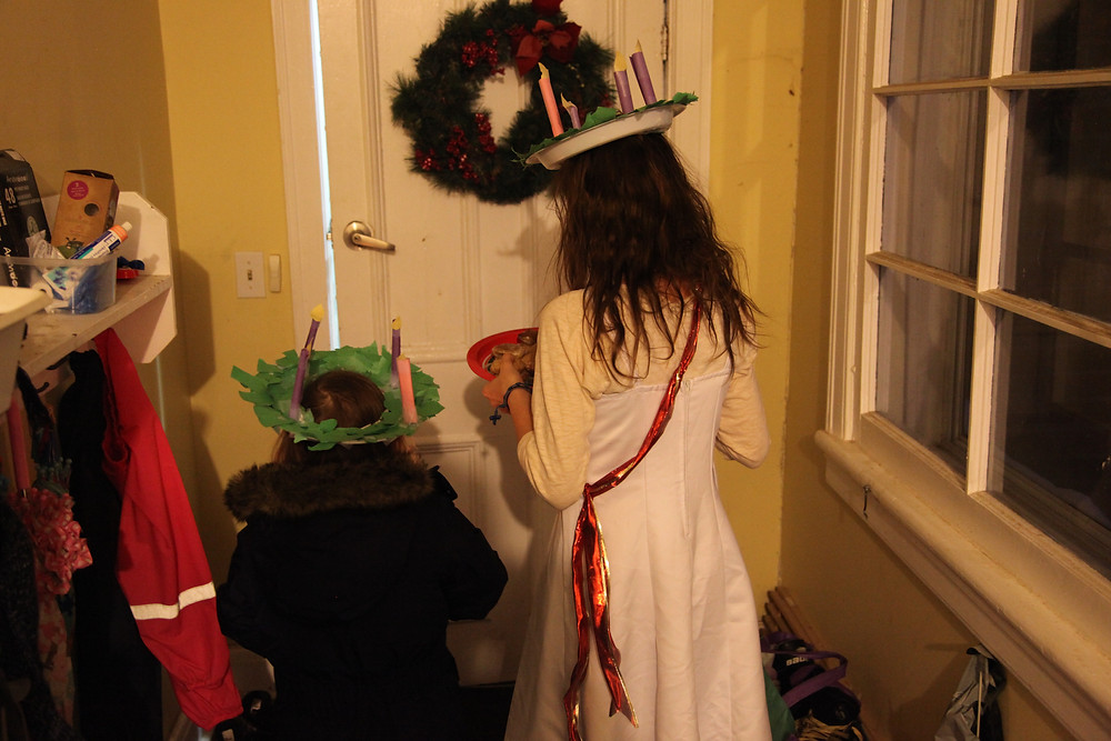 Delivering cookies on St. Lucy's feast day