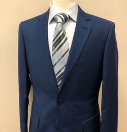 blue suit blue tie cropped