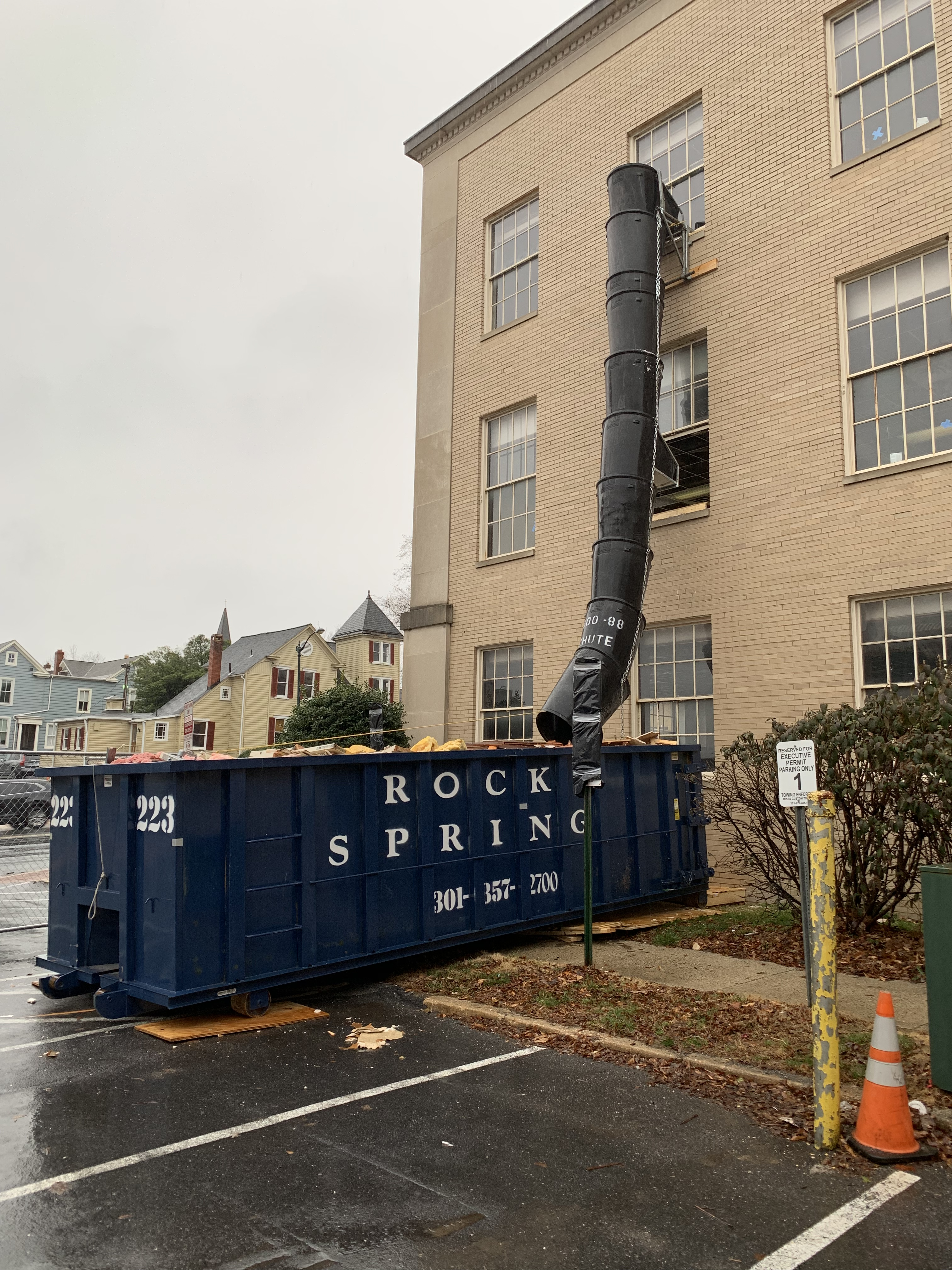 Dumpster with chute