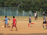 Children playing soccer at Rishi Valley