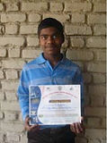 Child with award at Rishi Valley Rural Education Center