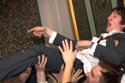 Groom crowd-surfing to live music