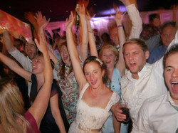 Bride & groom dance with guests