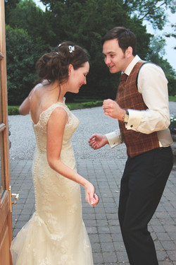 Bride & groom dance outside